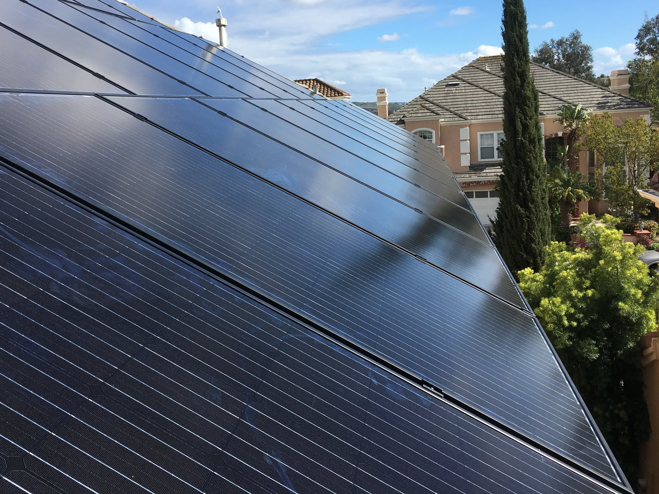 LAGUNA HILLS, CA - 33 high efficiency PV modules total to 10.23 kWDC located in Laguna Hills. This system was commissioned in 2018 and is expected to save the Homeowner over $170,000 in electricity bills over the next 25 years.