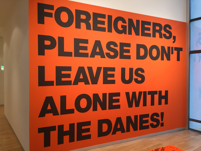 During 2002 the poster with the wording 'Foreigners, please don't leave us alone with the Danes' was put up in the streets as a comment on the increasing harsh climate in Denmark with regards to public debate on immigrants and issues on integration.  - via https://superflex.net/tools/foreigners_please_don-t_leave_us_alone_with_the_danes/image