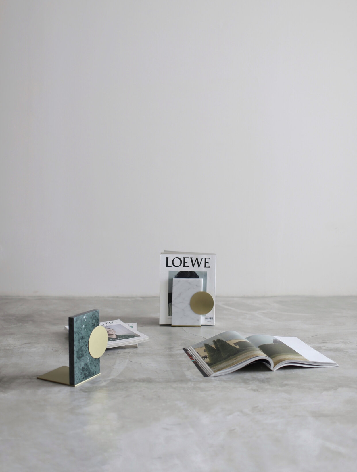 BUKU   Marble base with brass hardware bookends  -   SIZE   17cm(W) x 15cm(D) x 20cm(H)  -   MARBLE OPTIONS   Carrara, Nero Marquina, Royal Green  -   PRICE   Rp. 750.000