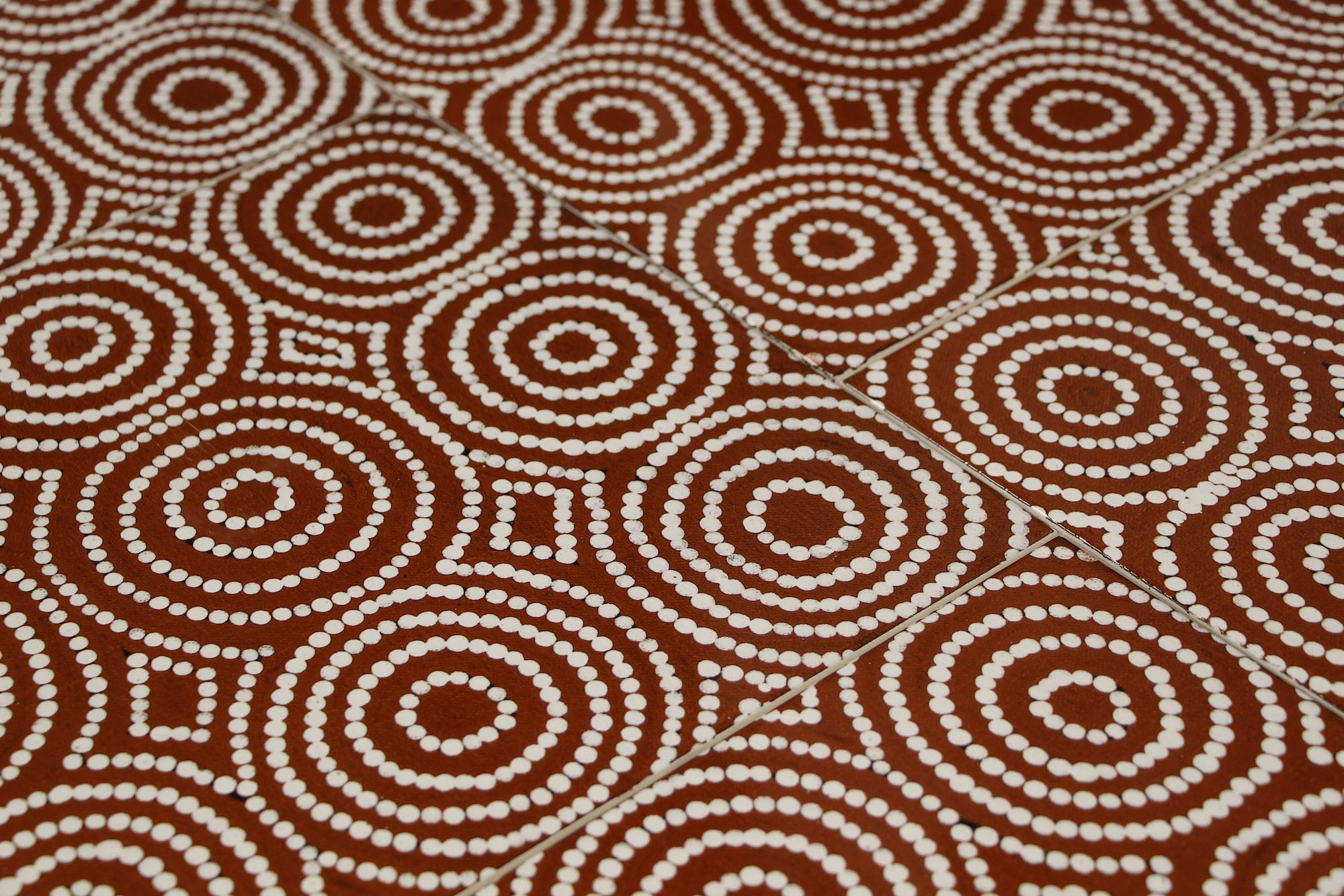 Detail of our  award winning Bush Onion 1 ceramic wall tile , from an original Australian Aboriginal painting.