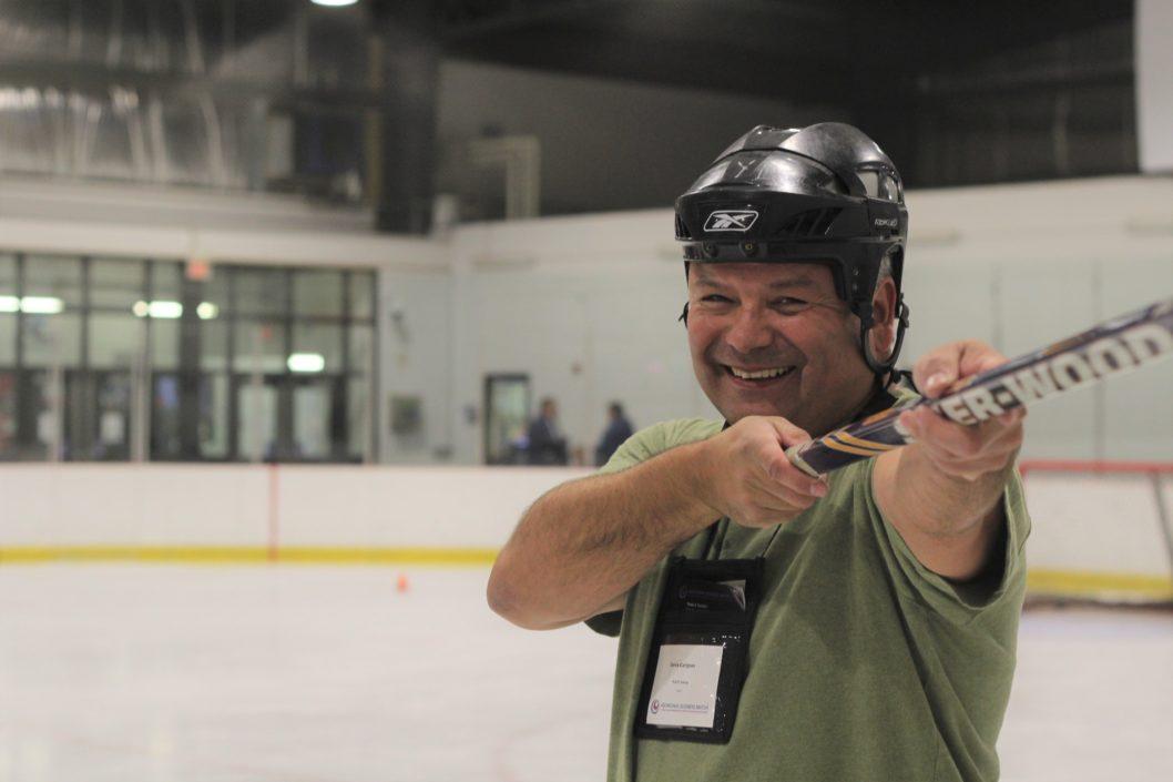 Denis Carignan, President of PLATO Testing, wins the ABM Hockey Challenge at ABM Alberta.