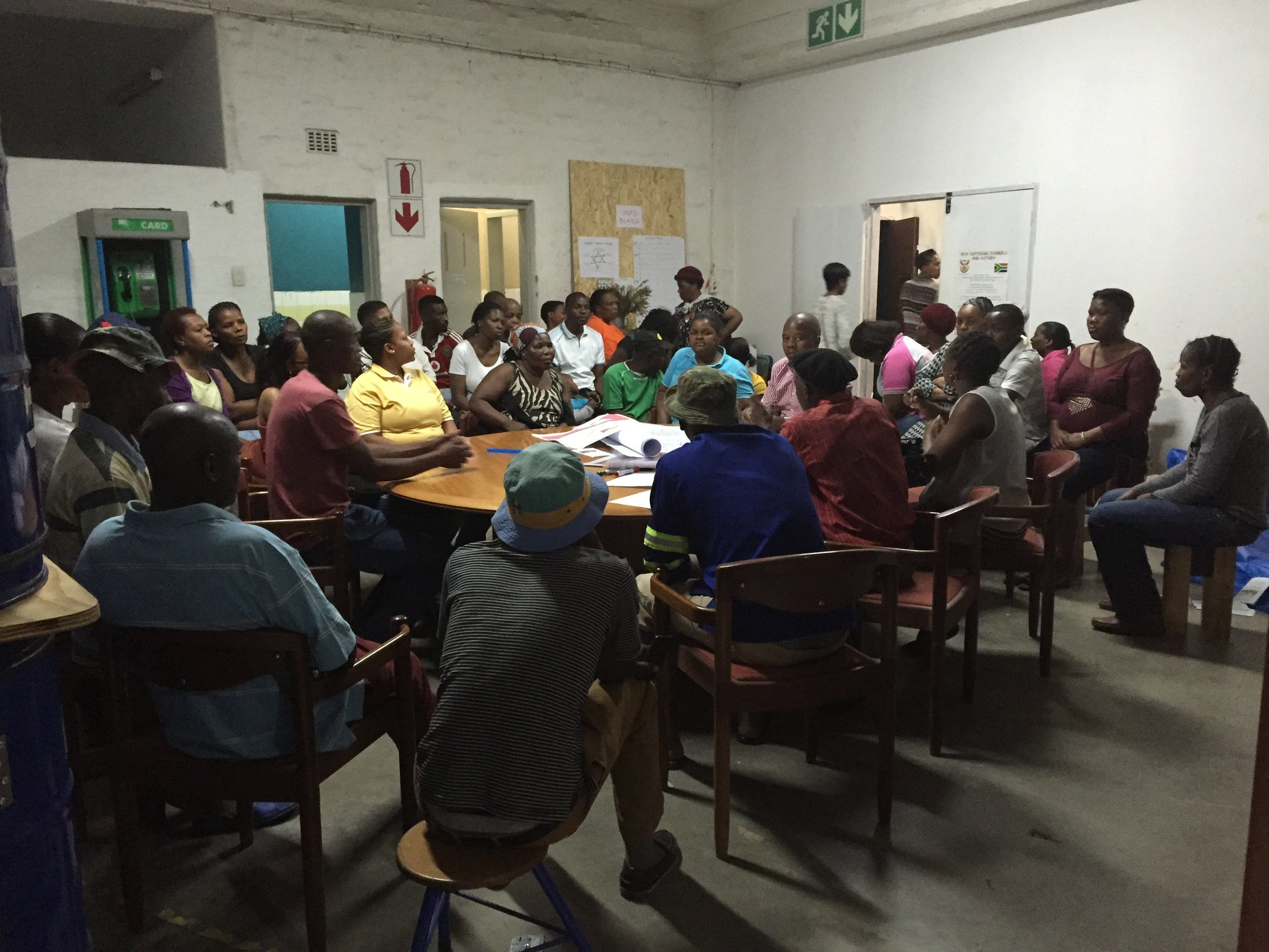 Community forum meeting taking place in Bjala Square