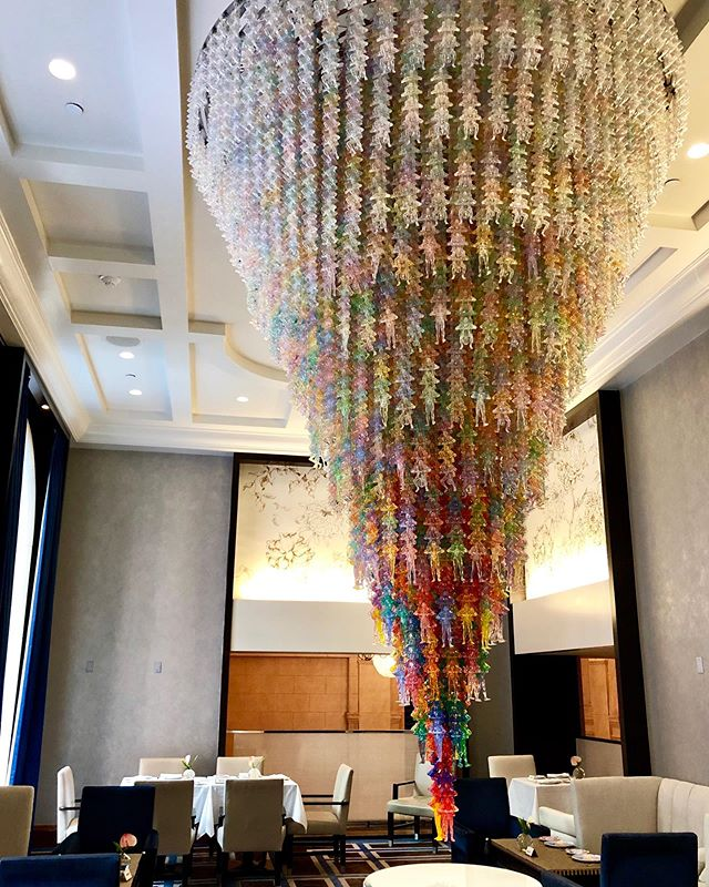 """Always love a chandelier, but this stunner is special: #DoHoSuh's """"Cause and Effect"""" is composed of hundreds of colorful, acrylic sculptures, a part of the artistic collaboration between @lehmannmaupin and @peninsulahotels"""
