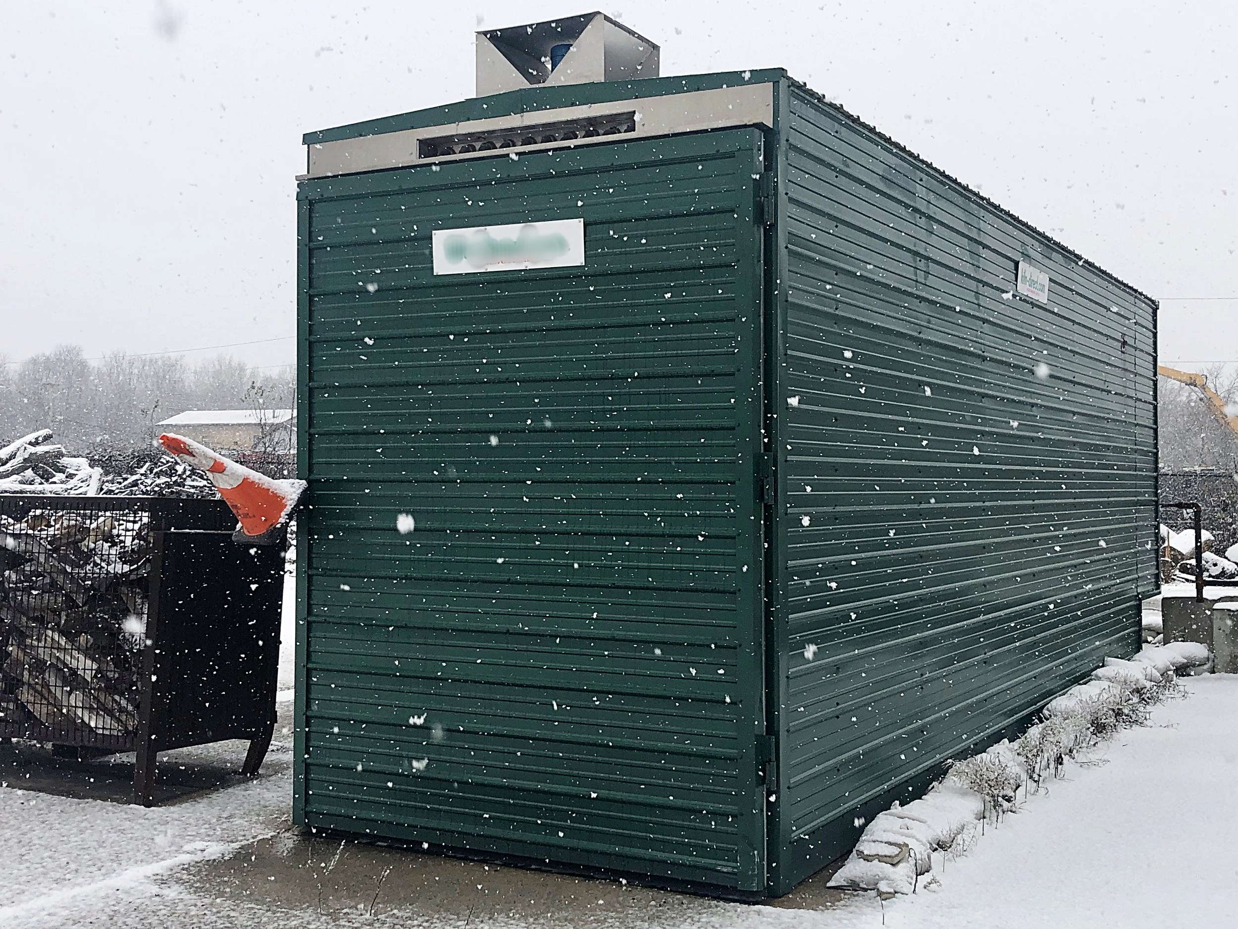 A picture of our kiln used up at the North Yard. Firewood is loaded into large crates and dried for up to 2 days at high temperatures to ensure low moisture content.