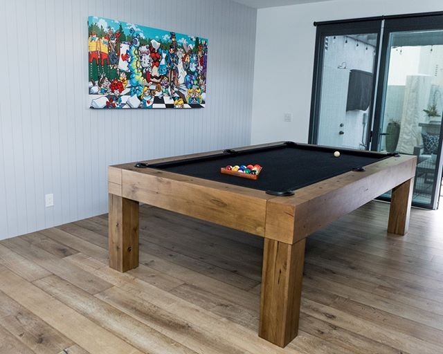 "Time for a little mid week fun!  Can't decide what we love more, the rad pool table or our light rustic, 7.5"" floor, which by the way is one of our most popular platforms. The gorgeous color and the insane durability is what makes it a fan favorite.  This floor is perfect for someone who has kids, dogs or loves to entertain.⁣ .⁣ .⁣ ____________________________________________⁣ ⁣ #warrenchristopher #warrenchristopheroc #texturesbywarrenchristopher #textures #woodisgood #warrenchristophercollection #woodfloor #woodfloors #woodflooring #customwood #customwoodflooring #eurooak #frenchoak #wideplank #wideplankfloors #ihavethisthingwithfloors #custom #wood #floors #interior #design #stairs #homeimprovement #herringbone"