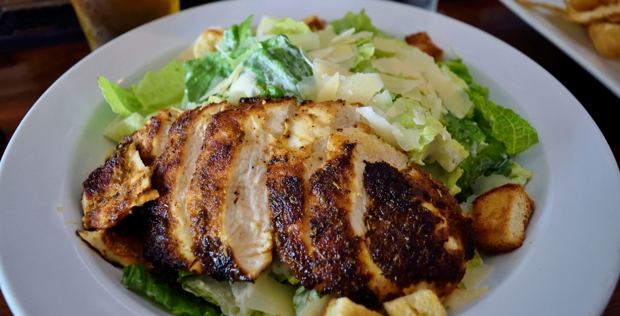 Blackened Chicken Caesar Salad brings all the croutons to the yard.