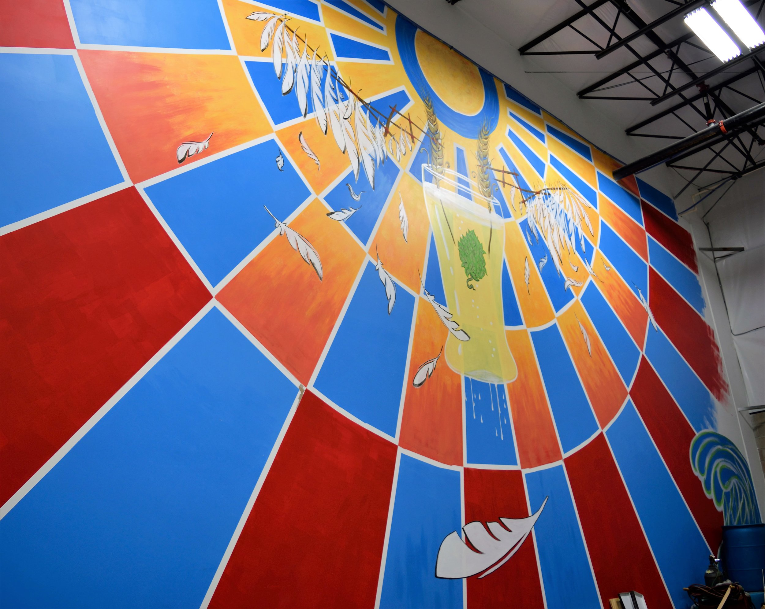 """Beautiful mural welcomes you to the """"outer"""" taproom at Icarus Brewing."""