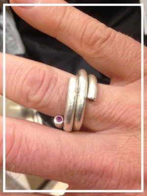 worn as one ring now but it is a future heirloom for two.  sterling nesting rings with rubies.