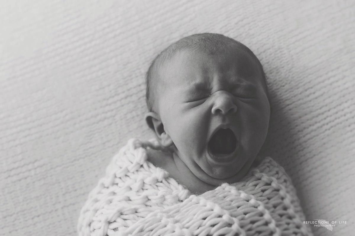 newborn-baby-yawning-natural-light-studio.jpg