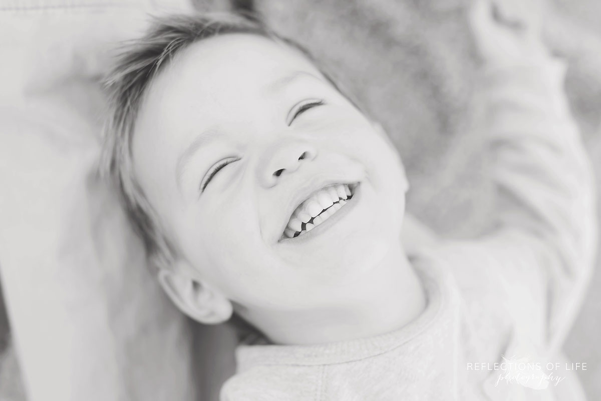 little boy laughing professional photographer