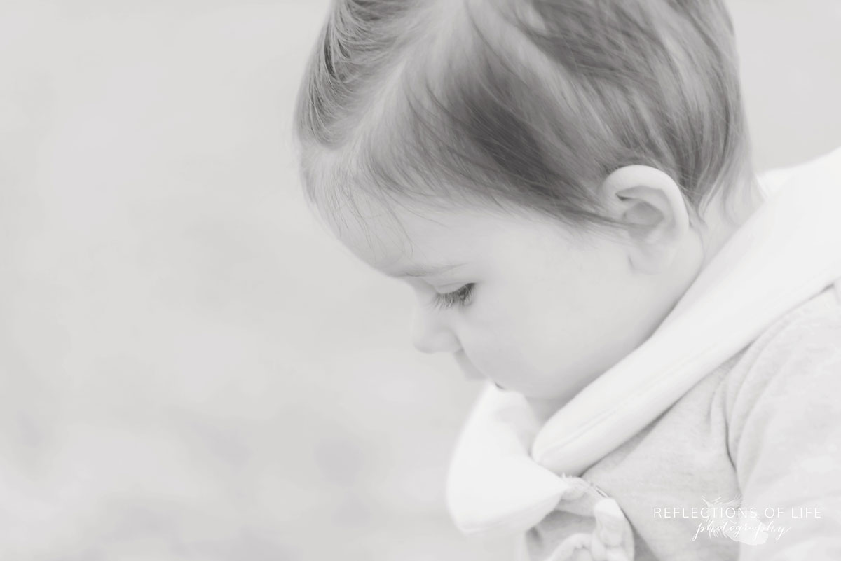 peaceful baby portraits on the beach in Ontario Canada
