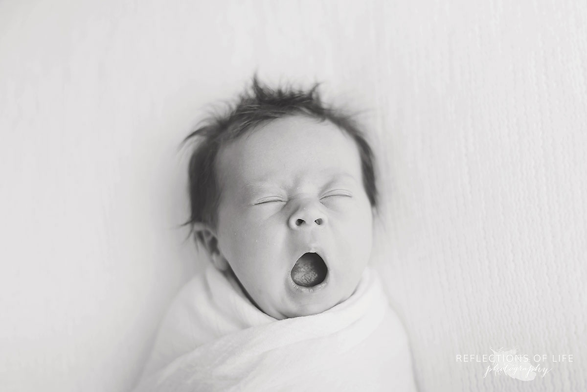 Creating A Meaningful Newborn Portrait Experience newborn baby yawning professional photography St Catharines ON Canada