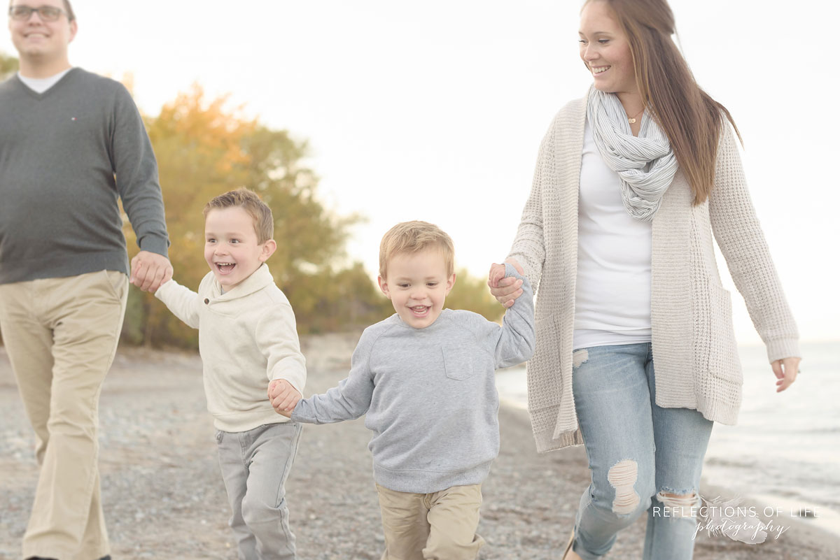 candid family photos on the beach in grimsby ontario canada