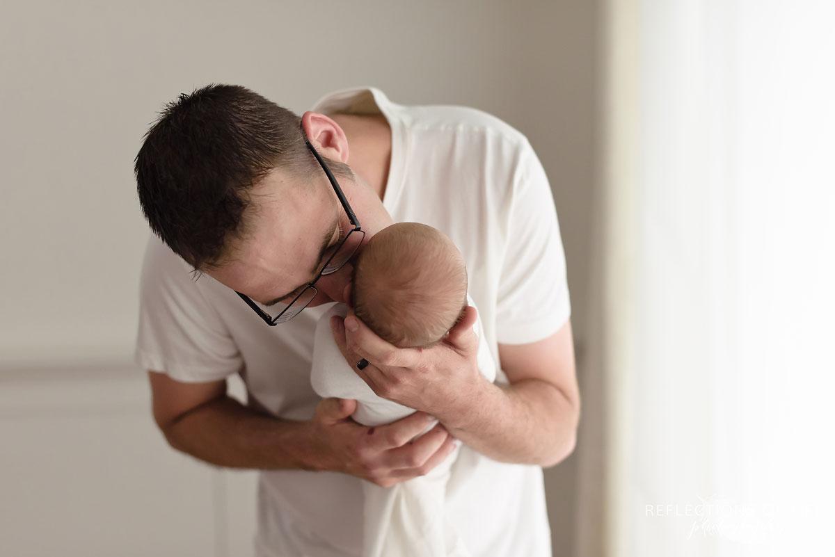 018 Daddy snuggles in to newborn baby Toronto Ontario Newborn Photographer