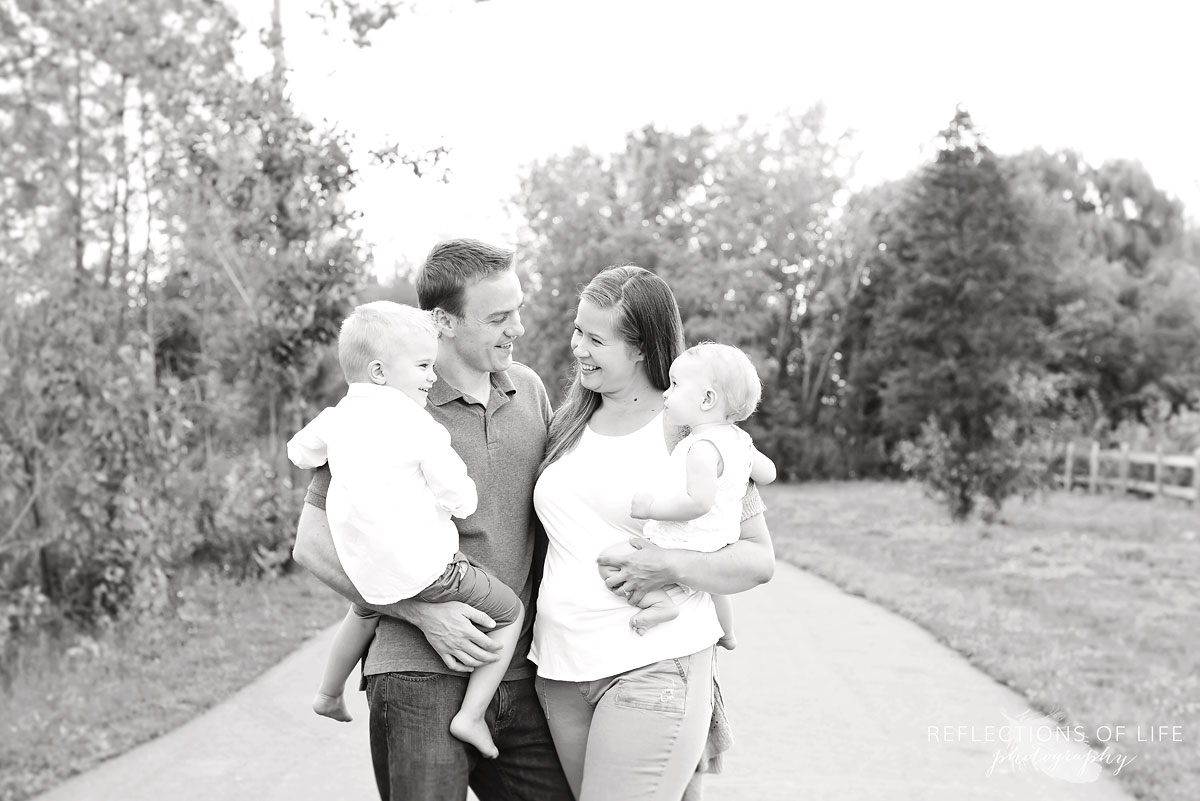 004 Niagara Family Photographer Mom Dad and Kids on a path in the park