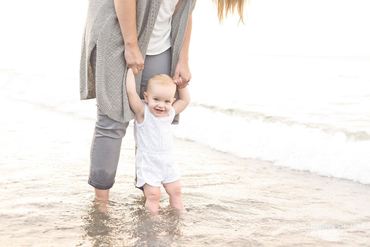 018 Adorable baby girl portrait on the beach in the water