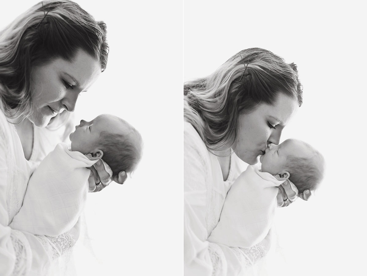 black and white image of mommy leaning down and kissing her newborn baby boy 014