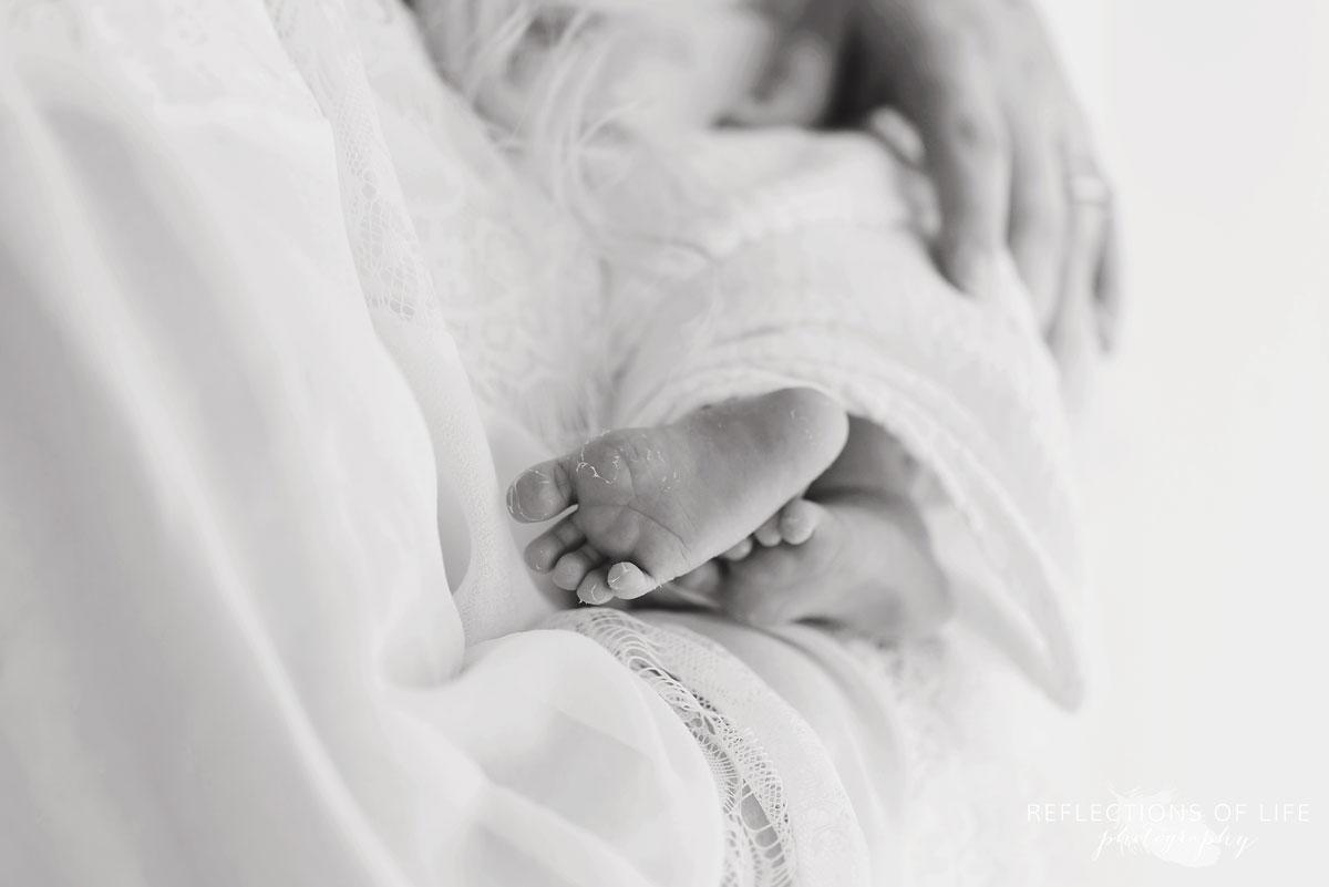 black and white photo of newborn baby boy toes 019
