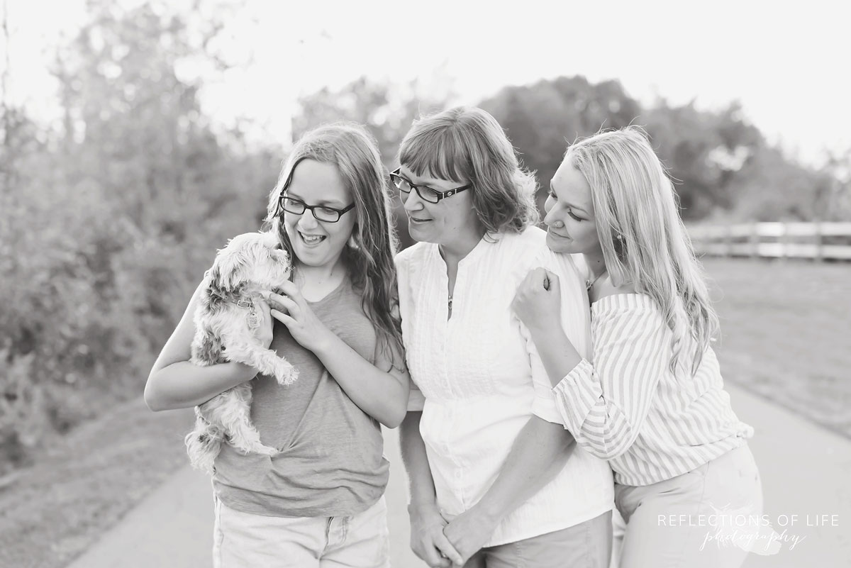 Mother and daughters and dog on the path in Grimsby Ontario Canada