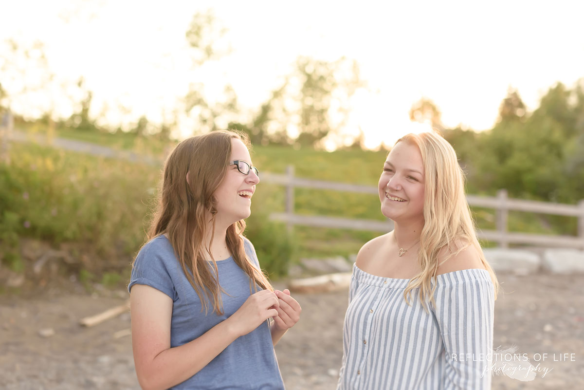 Sisters laughing on the beach near Lake Ontario
