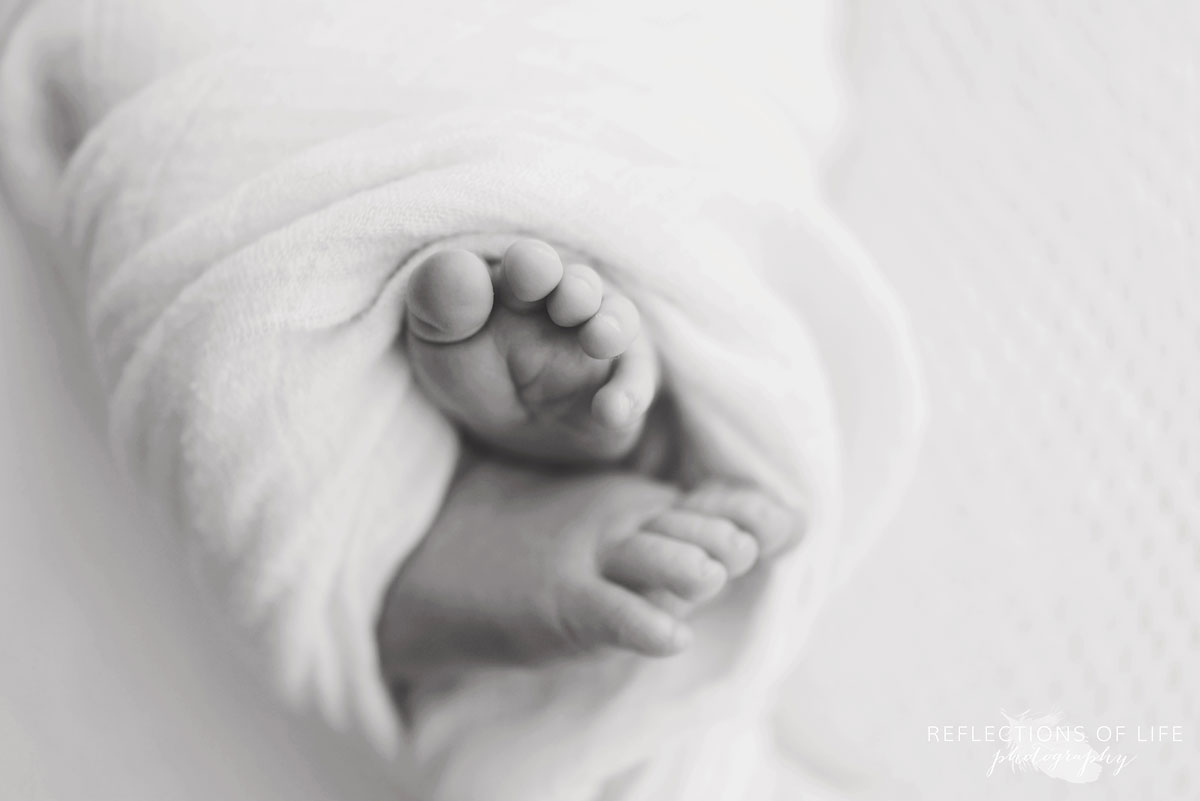 Newborn baby toes in black and whtie