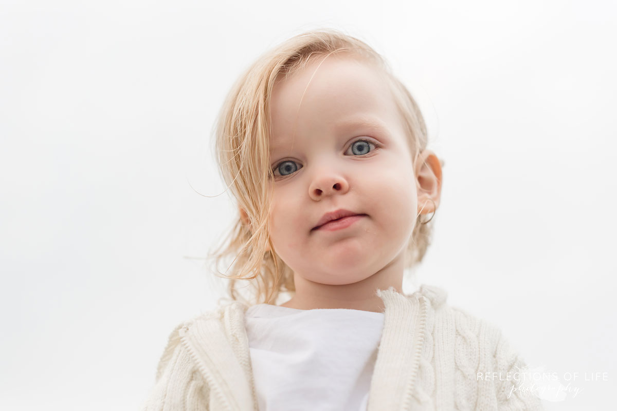 Photo of gorgeous toddler boy looking down at the camera.jpg