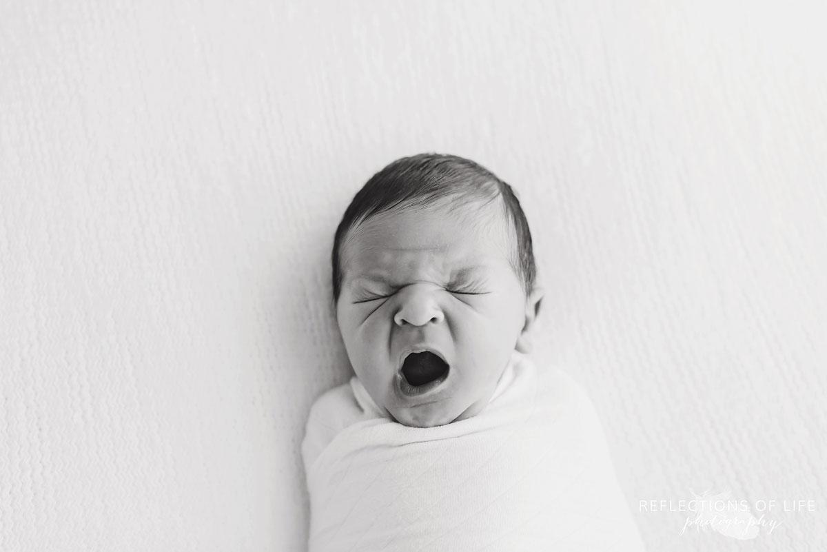 Professional photos of newborn babies yawning