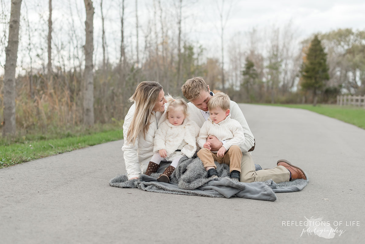 Family cuddling in fall of 2017 in Grimsby Ontario Canada