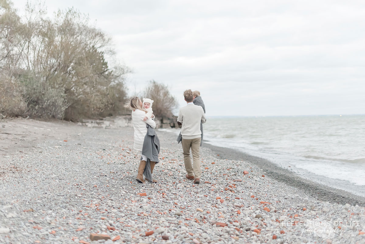 Famly photography on the beach in winter Canada