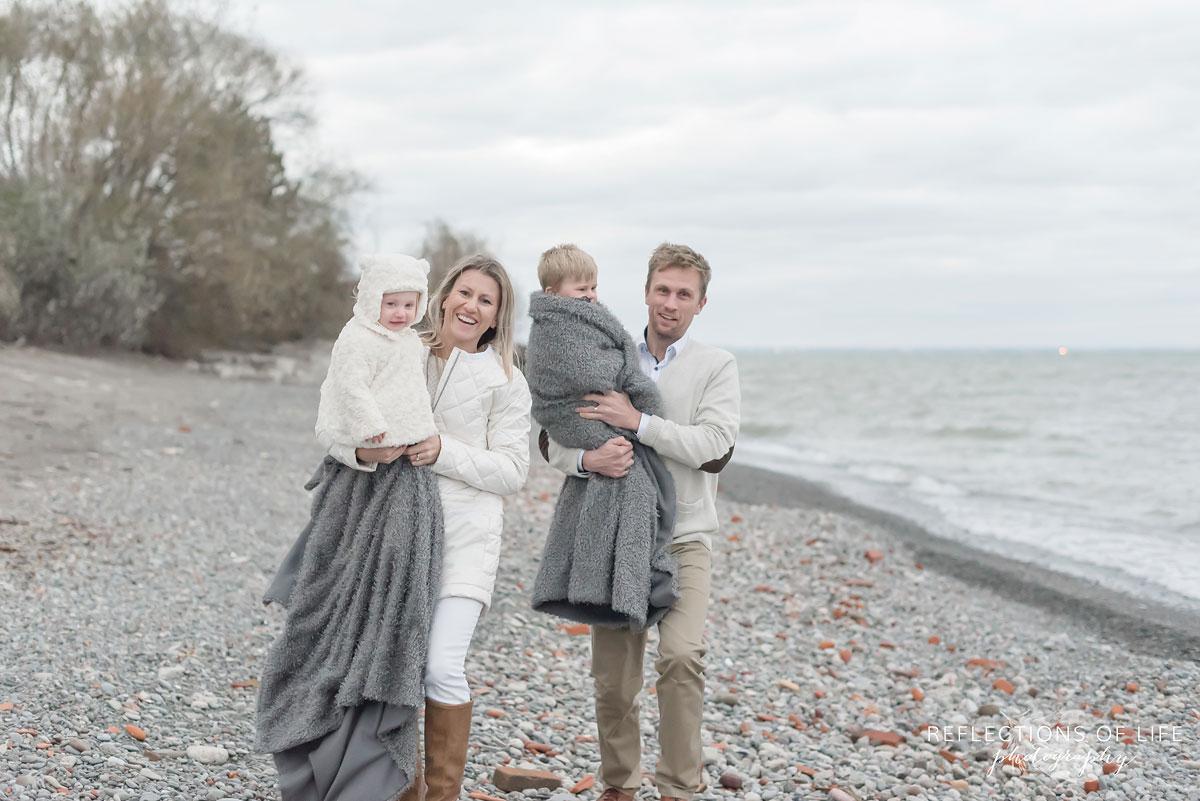 Family photos on the beach in winter in Ontario Canada