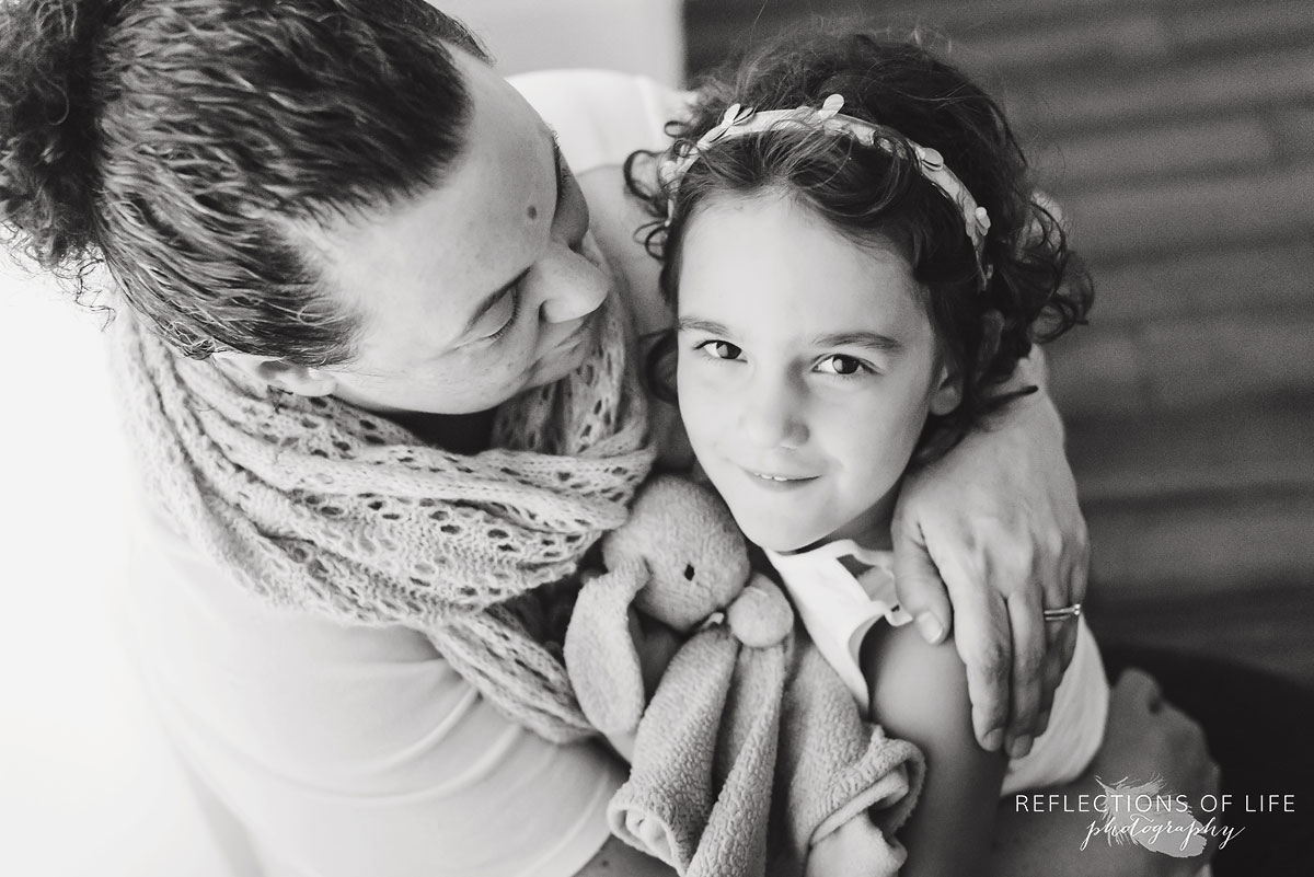 mother holding daughter black and white