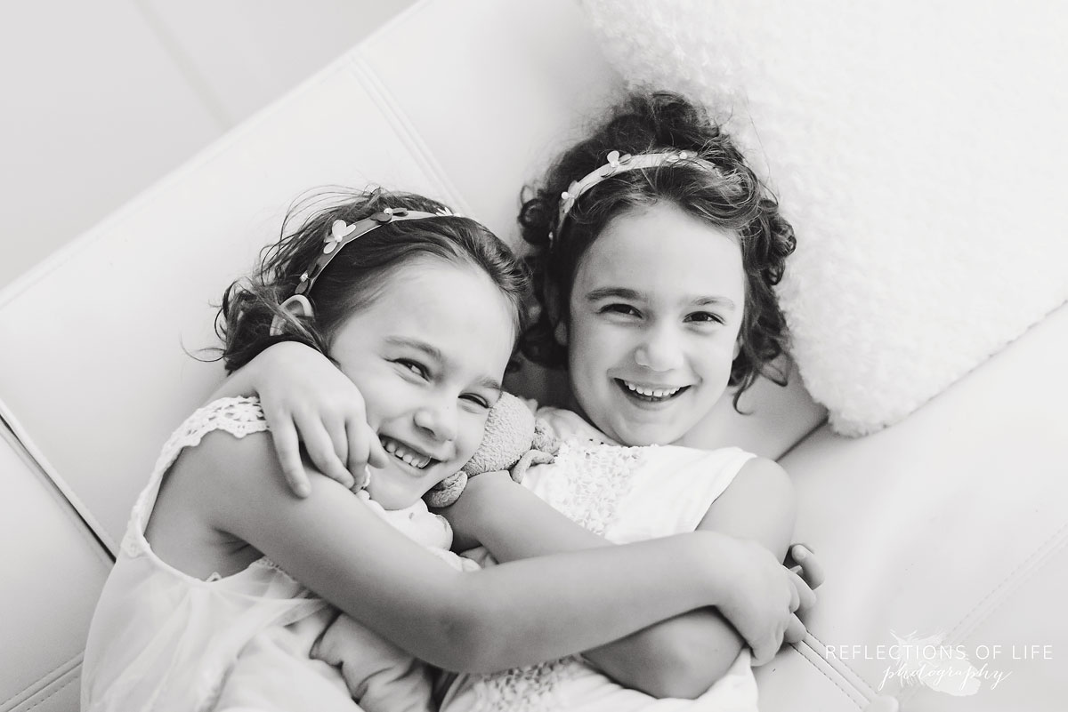 twins hugging black and white