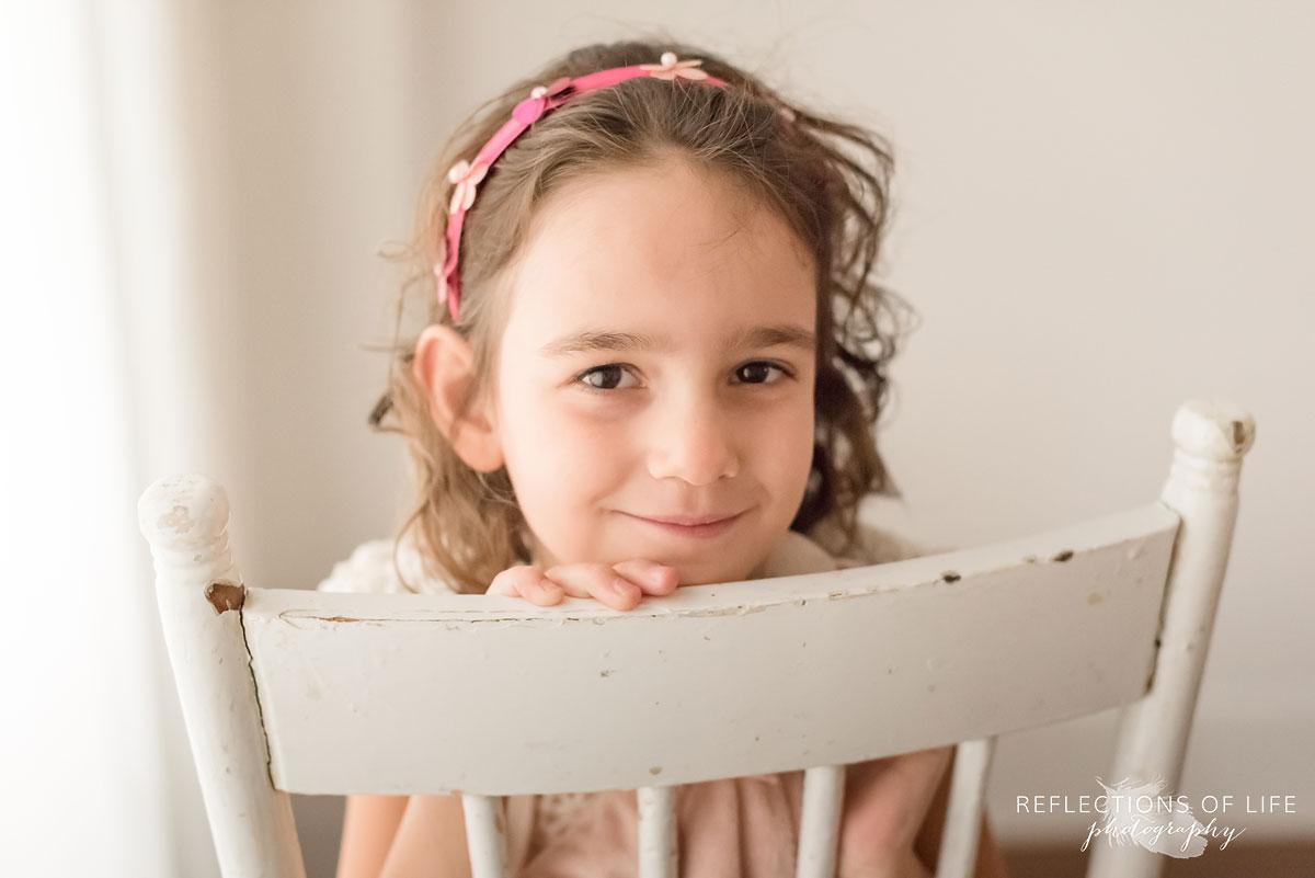 little girl in white studio natural light photography.jpg