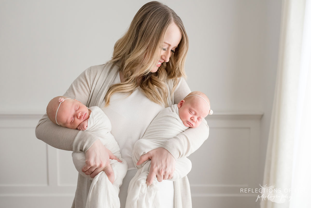 mother holding newborn twins