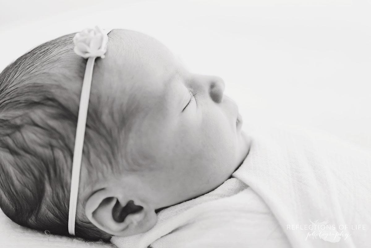 side profile of newborn baby girl in natural light photo studio grimsby ontario