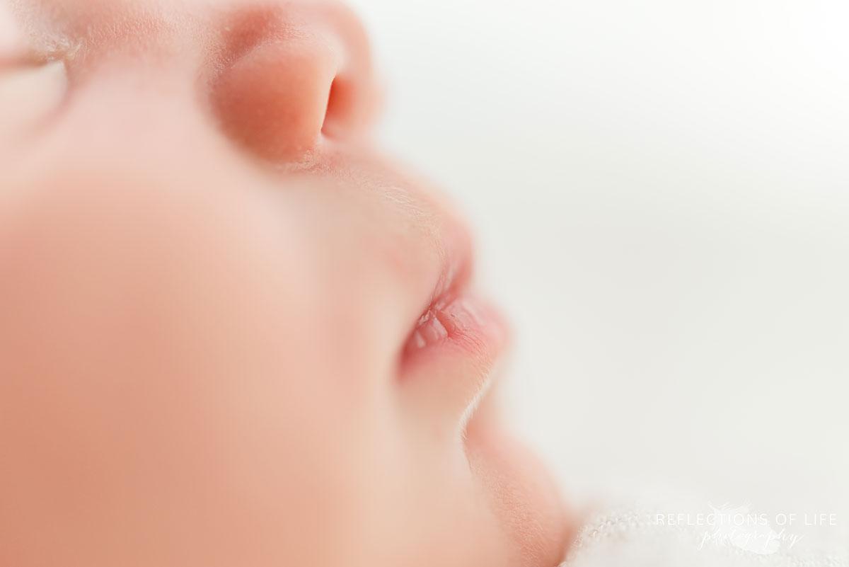 Close up photo of newborn baby girl lips