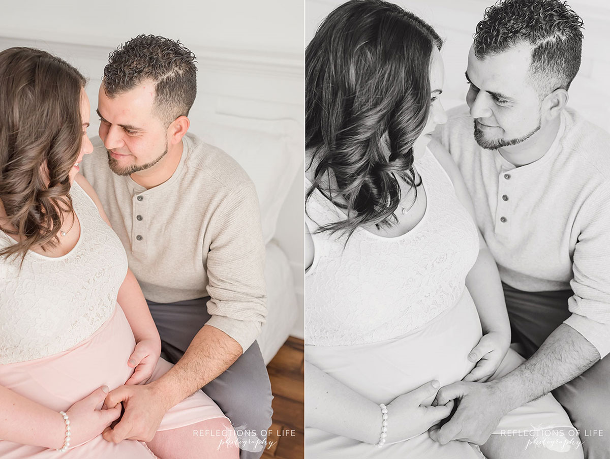 pregnant mom and dad looking into each others eyes