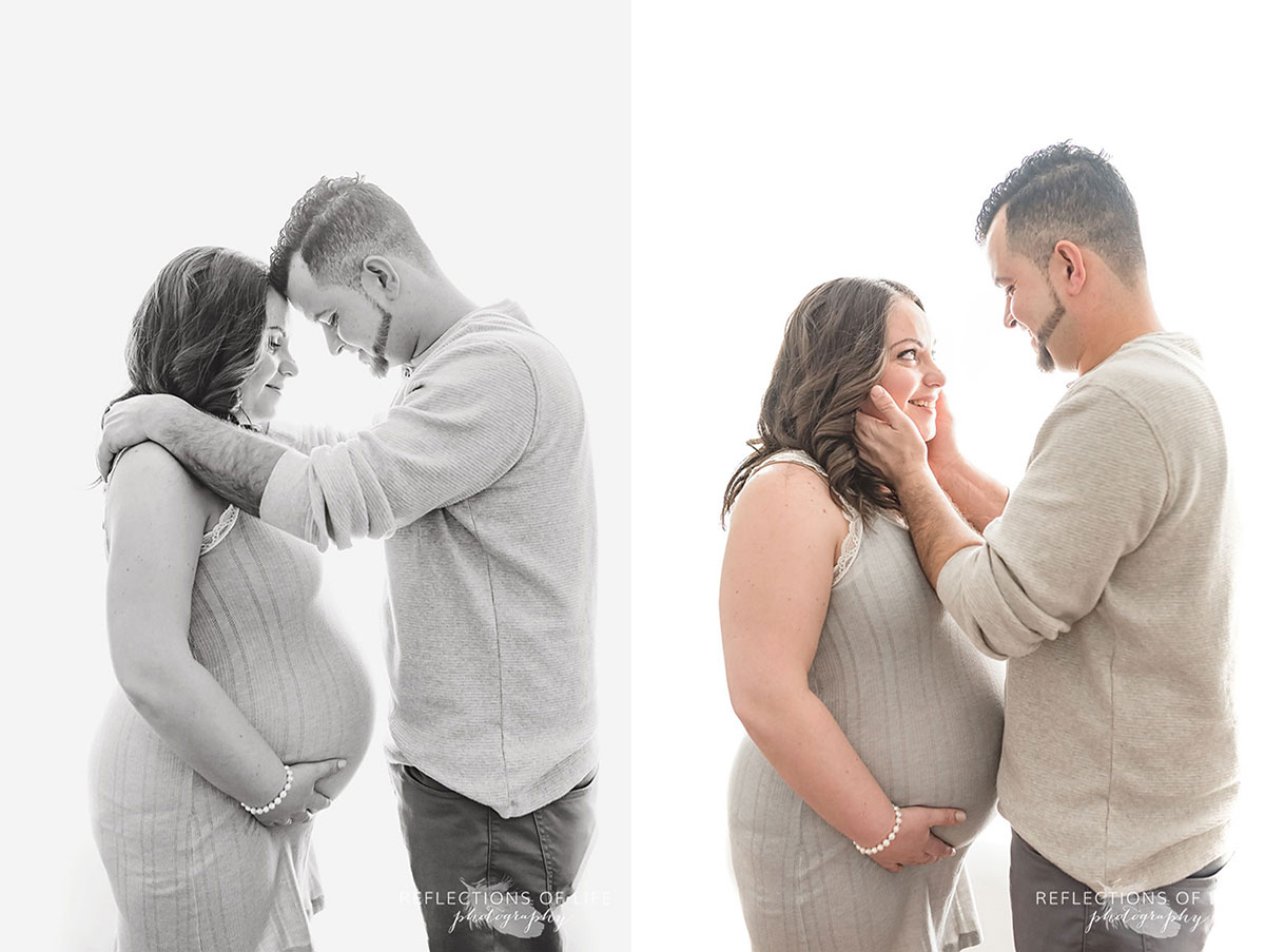 Gorgeous pregnant mom and her loving husband backlit in natural light studio