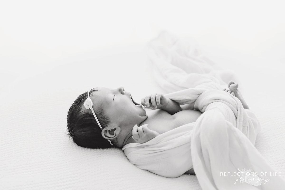 Newborn baby yawn in black and white