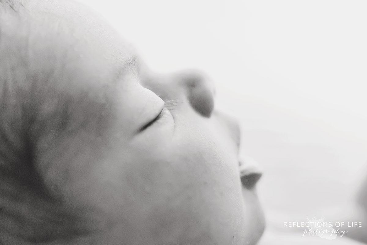 close up of newborn baby girl eyelashes
