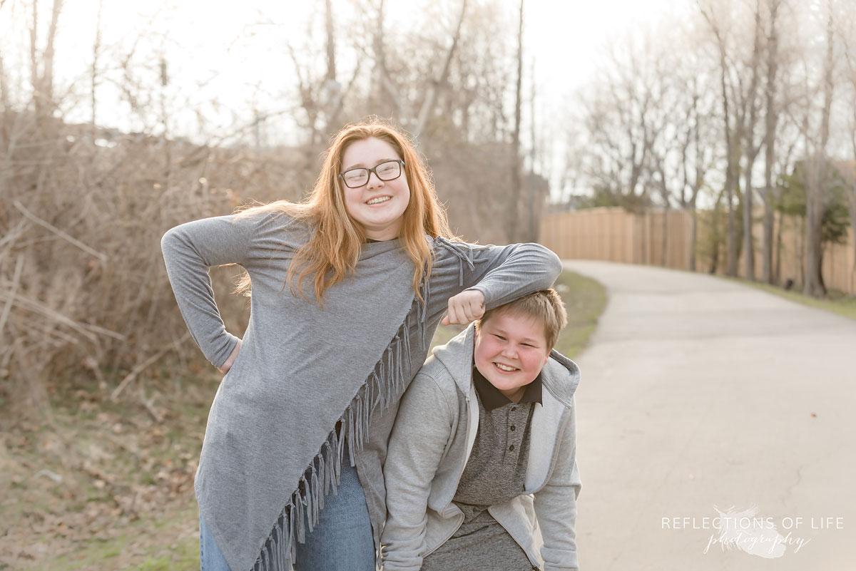 Siblings on a pathway in Niagara Region of Ontario