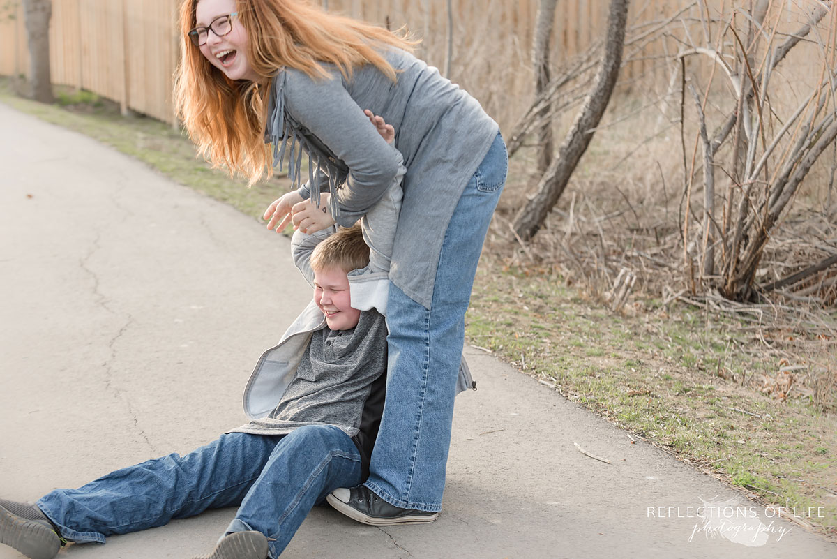 Fun candid sibling photography in Grimsby Ontario Canada