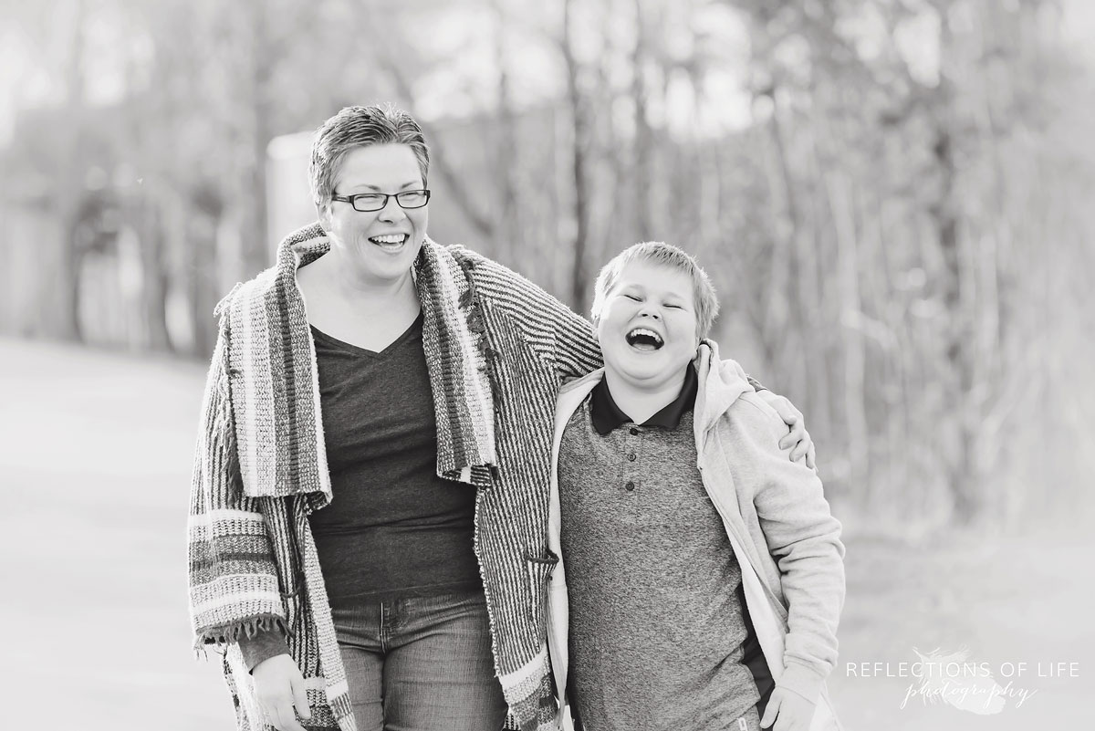 Mother and son laughing together