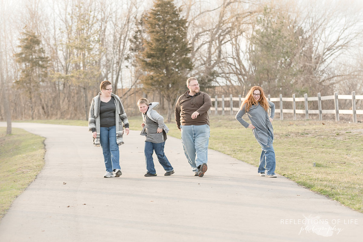 Family walking funny down a path
