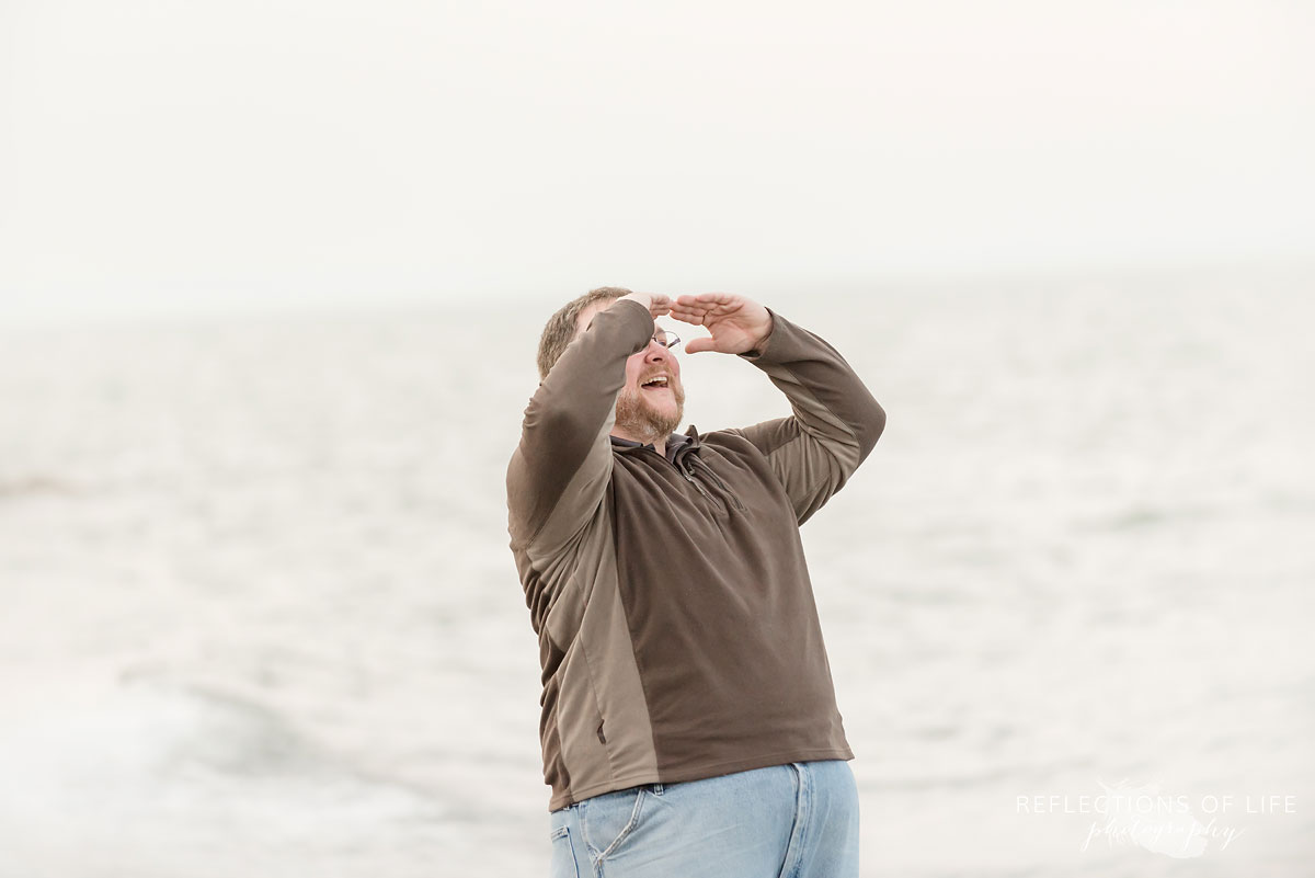 father looking out over the water of Grimsby Ontario