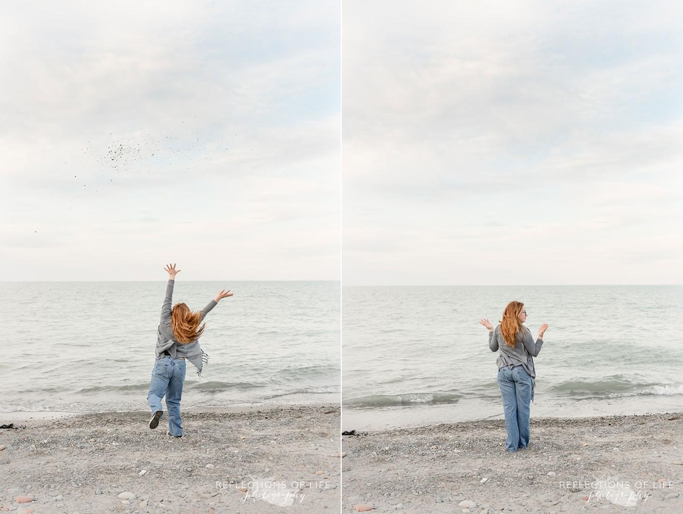 Redhead girl throwing rocks into grimsby beach
