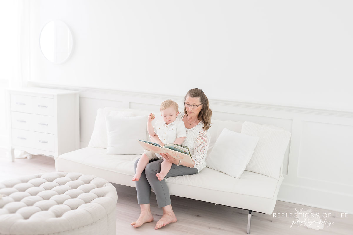Grandma and grandson photography reading a book