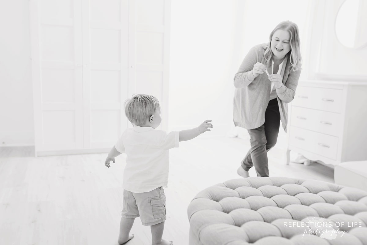 Mother and baby playing black and white photography