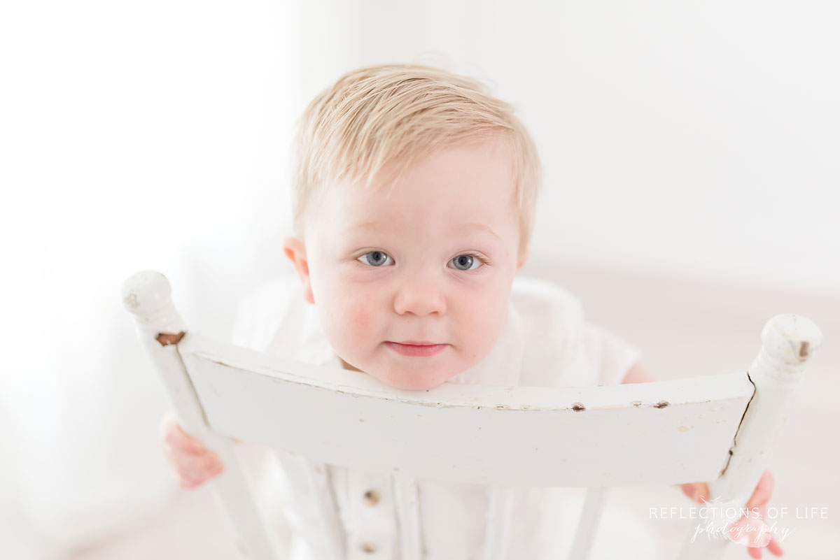 High key baby with white chair