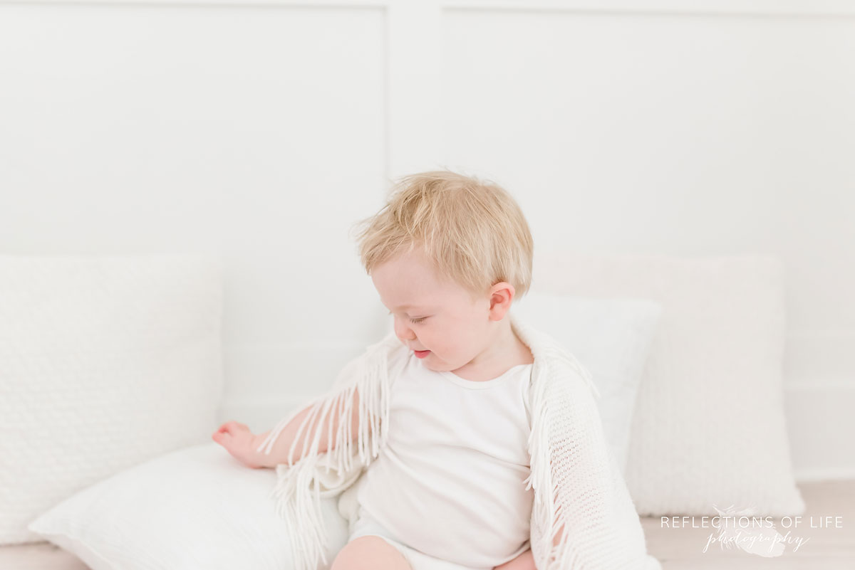 White background photography baby with pillows and blanket
